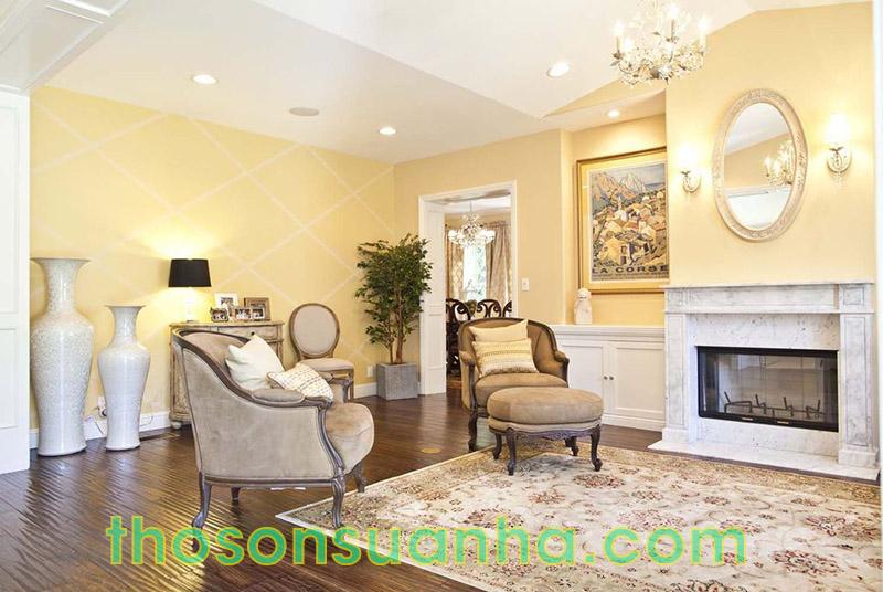 Sơn tường phòng khách màu vàng quý phái